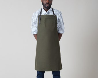 """Dahls"""" 10.10oz water repellent olive duck canvas apron. Leather straps Handmade in Montreal"""