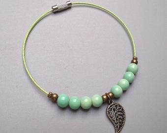 Handmade bracelet pistachio green glass beads.