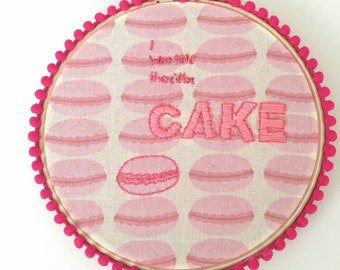 6in I was told there'd be cake hoop with hot pink pom pom trim.