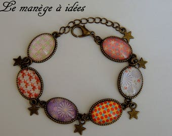 Bracelet / Cabochon / glass/Metal/Bronze adjustable, the ring has Vintage colors.