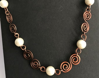 Necklace with swirls and pearls