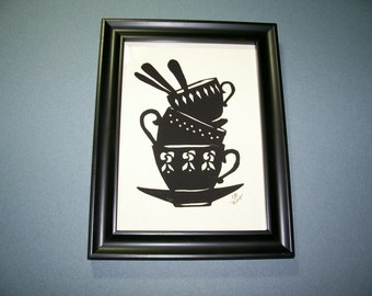 CB 104 Papercutting of stacked teacups and spoons.