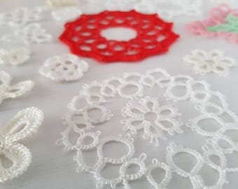 A miscellaneous collection of crochet and tatting medallions, and motifs.  Craft supplies