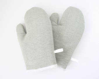 Soft green oven gloves