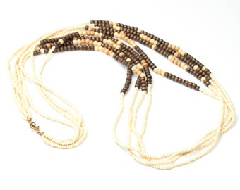 Long Mehrsträngige vintage necklace made of seed beads and wooden beads, Vintageschmuck