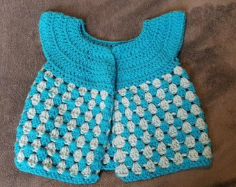 Little girl's cardigan. 3 to 5 years old