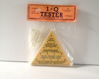 I Q Tester, Peg Triangle Board Game, made in USA, copyright 1975, New Old Stock in Original Package