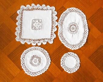 Set of 4 white fine linen doilies