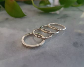 Sterling silver stacking rings, set of 4.