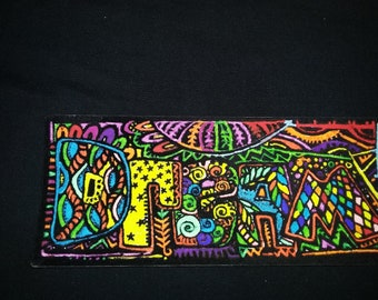 Felt print magnet colored with permanent marker