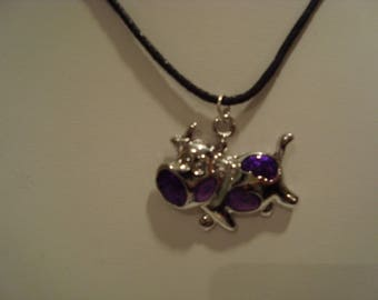 Purple cow pendant