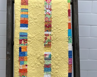 Baby Quilt Pattern, Scrappy fabric used to make a crib size quilt for your baby, an instant download baby quilt pattern, by Donna