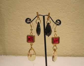 Gold squared earrings with red Swarovski crystal center and interchangable golden shadow and black drops. 3 pairs of earrings in 1!