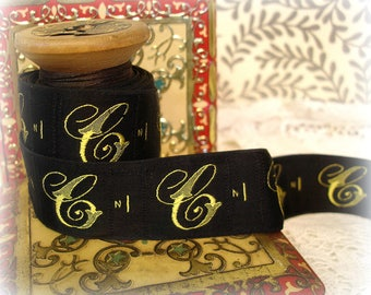antique french fancy monogram gold embroidered C monogram on black satin initial letter dressmaker label millinery ribbon