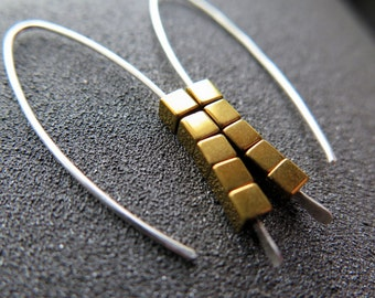 gold and silver earrings. mixed metal jewelry. sterling silver and gold earings.