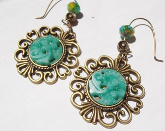 Variegated Vintage Green Glass Floral Cabochon earrings in ornate antique brass setting