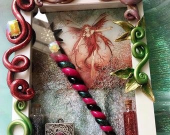 Fire  fairy shadow box with wand and bottled glitter.