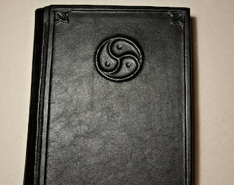 Large handmade leatherbound blank book with Triskelion-type BDSM emblem