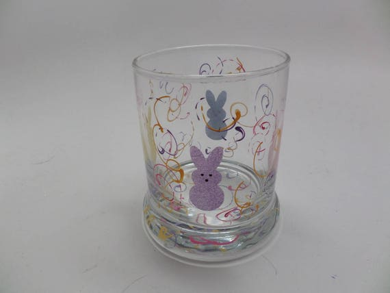 Hand Painted Bunny Candle Holder for Easter surrounded by bunnies and swirls