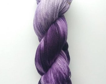 Naturally dyed withLogwood. Super fine merino lambswool, 100g, 600m.