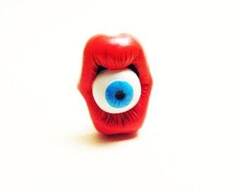 Pin's bouche et oeil bleu