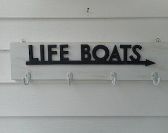 Wood and cast iron life boats  coat rack / beach decor / nautical decor