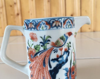 Cute vintage asian style cream cup