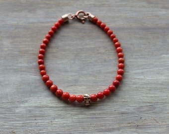 Men's Unique and Rare Undyed Coral Bracelet With a Rose Gold Skull