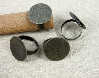 Large tray (x 4) bronze metal ring finding