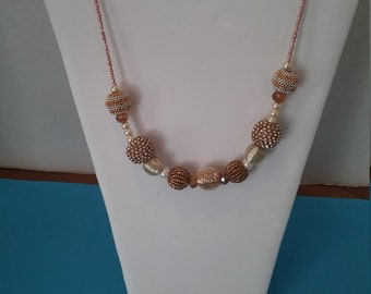 Gold and silver rounds necklace