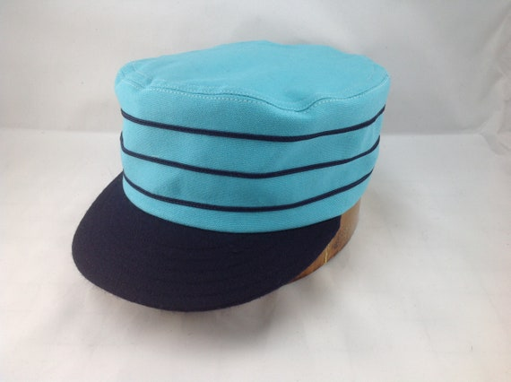 """Baby Blue cotton boxcap with 2"""" navy visor and soutache. Fitted to any size. Select size at checkout."""