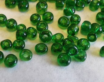 200 large seed beads 4 mm transparent green glass