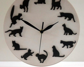 Multilayer wooden clock with black cats