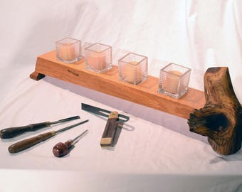 Candle centerpiece featuring live bark and steel candle holders