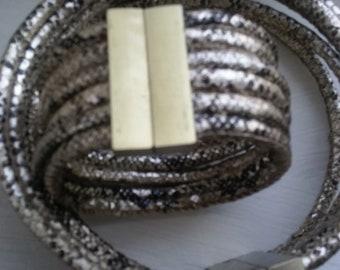 Metallic, magnetic faux snake cord cuff