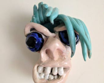 90's style claymation face fridge magnet
