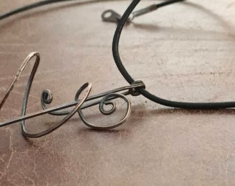 Hand crafted 3 dimensional copper pendant on leather necklace
