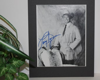 Larry Hagman Photo with Mat and Signed Autograph of Larry Hagman of Dallas . Professionally matted display measures a final size of 11x14.