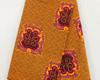African Fabric - by the yard - Wax/Dutch - orange, magenta, dark purple, brown - dotted emblem pattern.