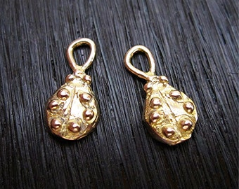 Two Small Artisan LadyBug Charms in Gold Bronze (two charms) (N)