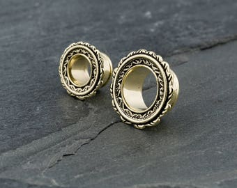 Gold feather gauges. unique ear gauges. plugs and tunnels. 6g 4g 2g 0g 00g 000g ear tunnels