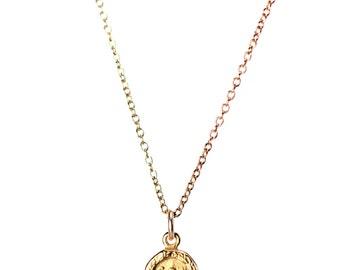 Gold buddha necklace - yoga necklace - meditation necklace - a gold buddha charm hanging on a 14k gold vermeil chain