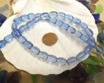 Strands of 10 mm x 7 mm Glass Oval Beads, Light Blue (1810)