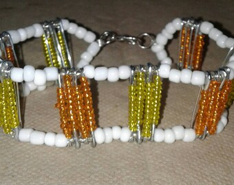 Safety Pin Beaded Bracelet with Orange and Yellow seed beads.