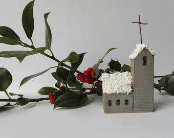 Winter church decoration. Little wooden folk art Christmas church. Snowy rooftop. Christmas decoration. Gift. Scandinavian Christmas