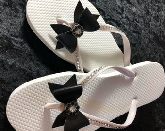 NEW!!!!!! White flip flop in faux leather bow with jewel in the center to match