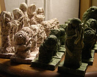 a Weird Horror Chess-Set in the Hues of Moss and Aged Bone