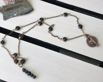 Mauna Loa Necklace with black glass beads, lavastone and dainty brass chain