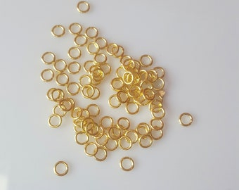 100 jumprings fine 6mm gold plated brass