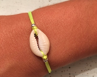 Neon yellow cord and shell bracelet